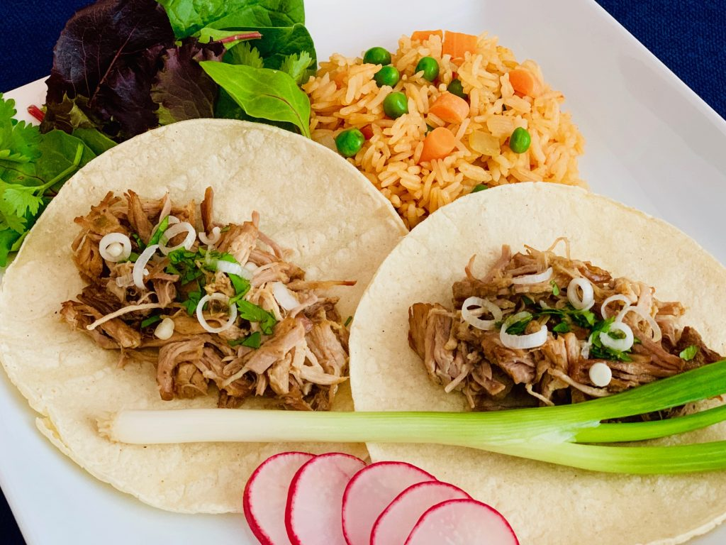 Carnitas tacos and rice