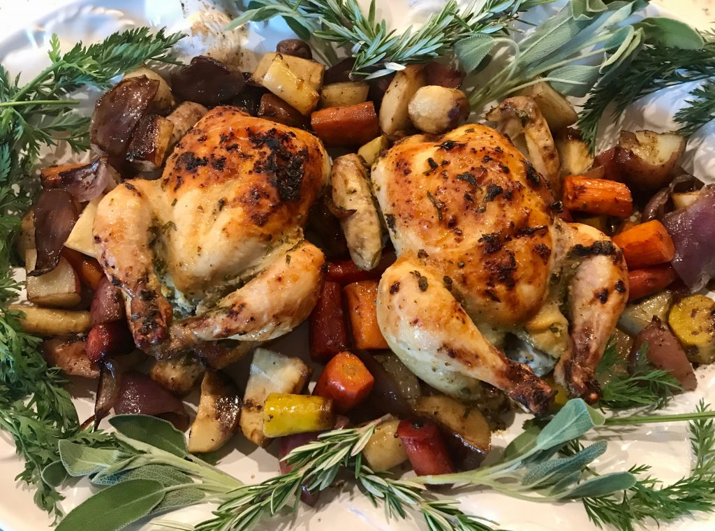 2 Game Hens on a plate with vegetables