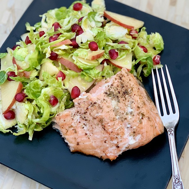 Brussel sprout, pomegranate, apple salad with salmon