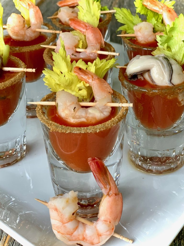Bloody Mary shooters with shrimp and oysters