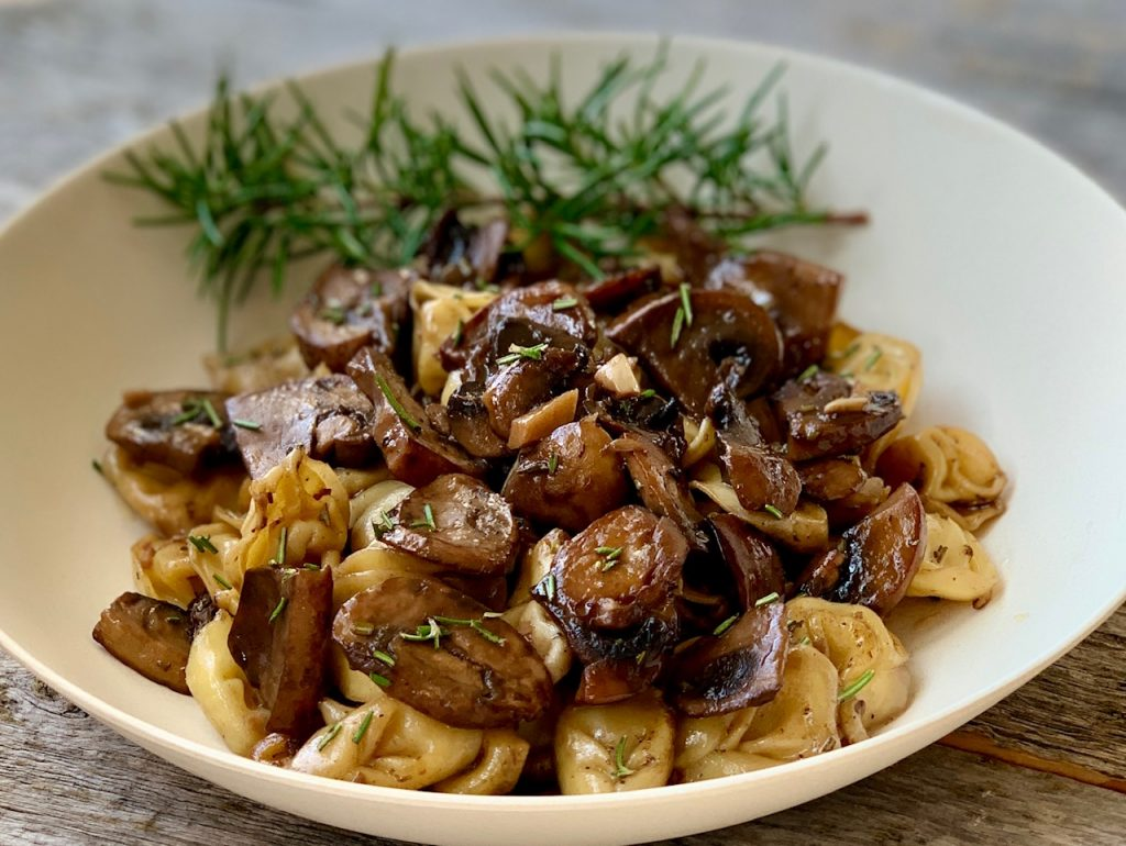 Garlic Herb Mushrooms in a bowl with pasta