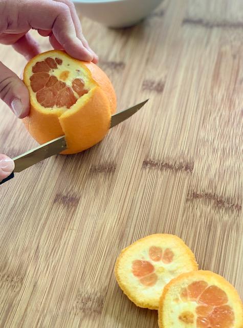 Cutting the peel for orange supreme