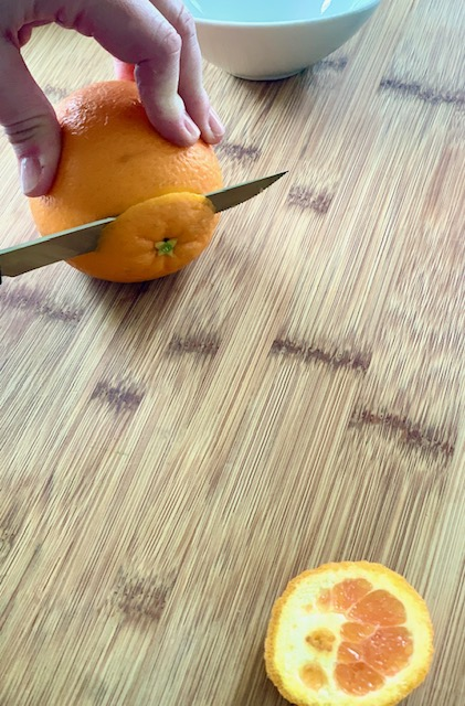 Cut off both ends of the orange