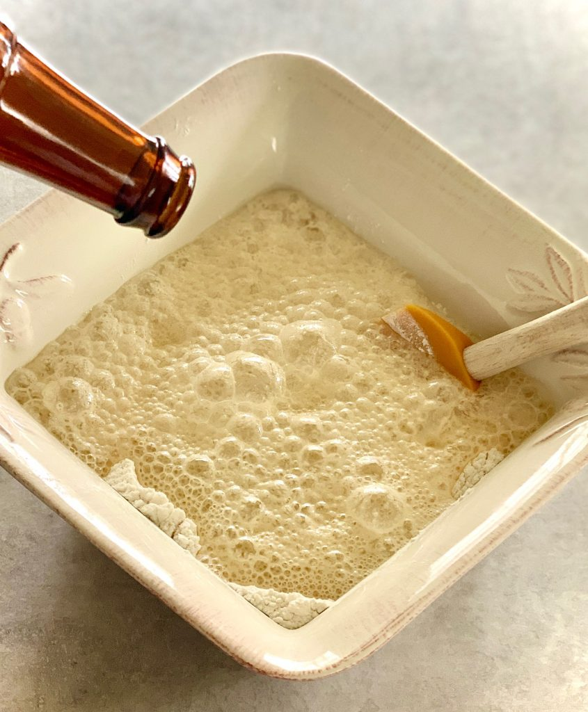 Beer being added to flour and sugar for bread