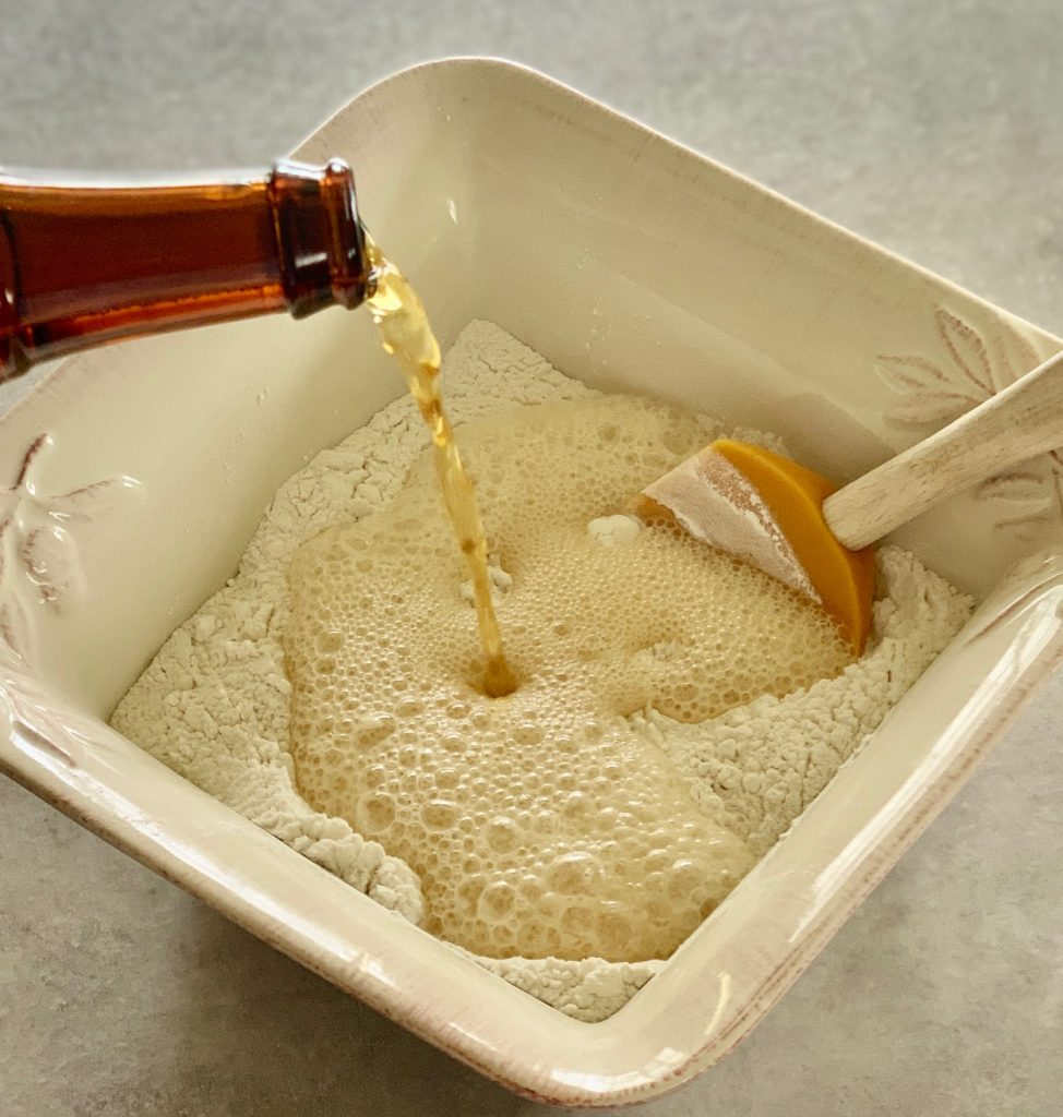 Pouring beer into flour and sugar