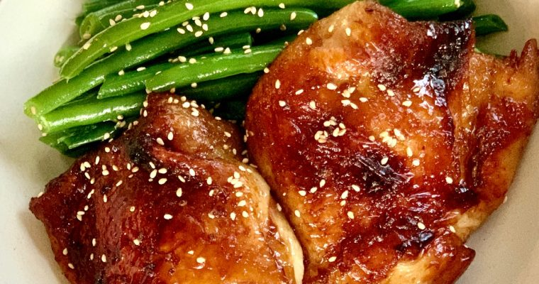 baked asian chicken with green beans in a bowl
