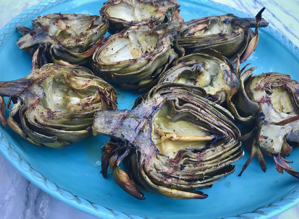 Grilled Artichokes on a blue platter