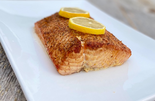 Cedar Plank Salmon with Potlatch Seasoning and lemons