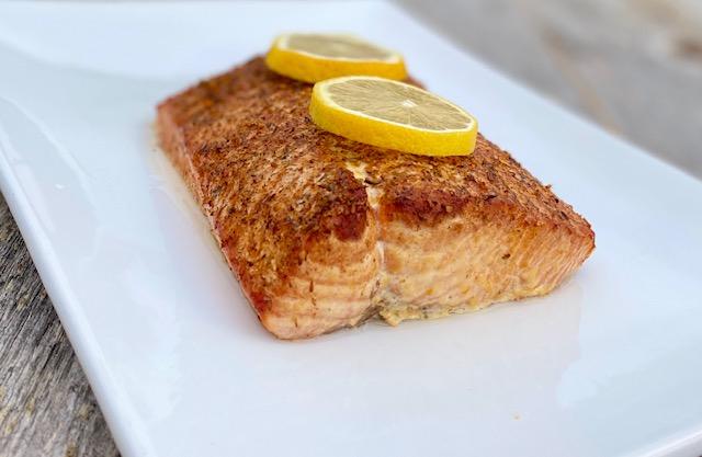 Cedar Plank Salmon with Potlatch Seasoning and lemons