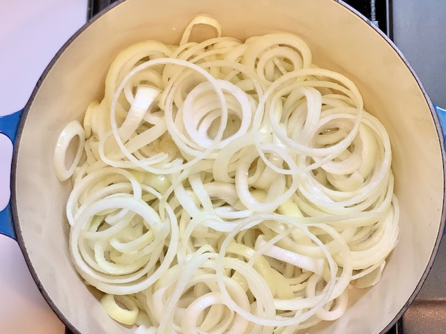 Sliced onions in dutch oven for French Onion Soup