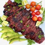 Carne Asada on a platter with vegetables