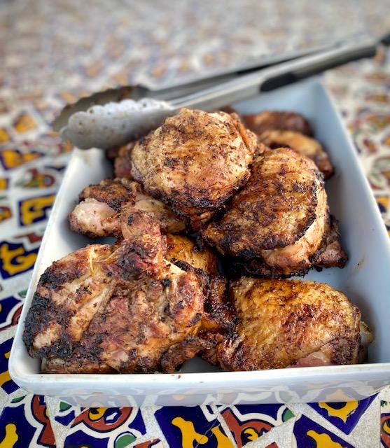 Jerk Chicken in a white baking dish