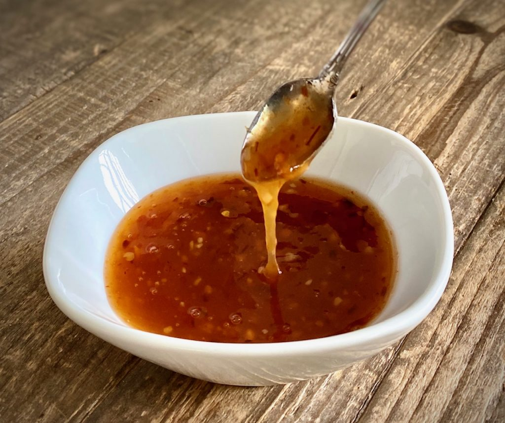 Sweet Chili Sauce in a bowl with a spoon