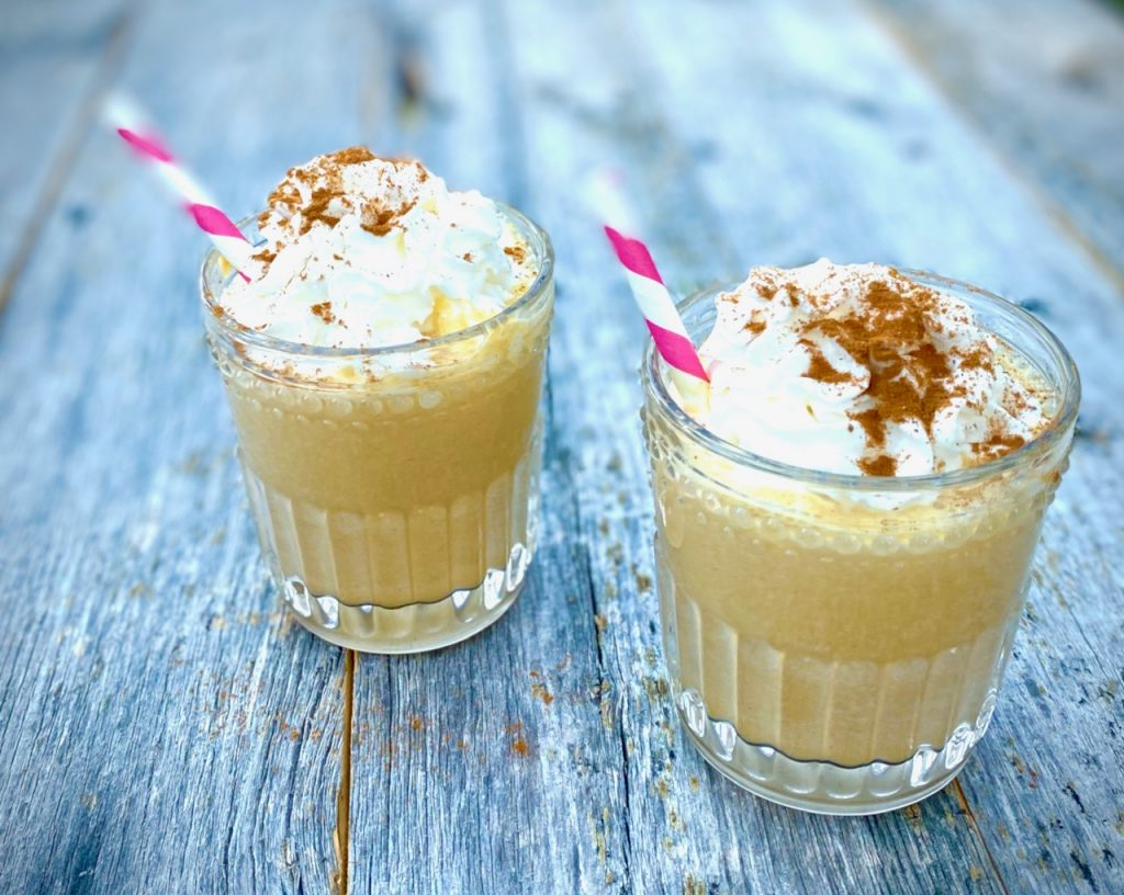 2 Pumpkin Pie Shakes with whipped cream and pink straws