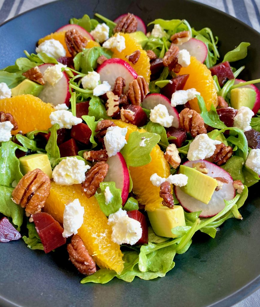 Arugula Beet Salad with goat cheese, oranges, avocado and radishes