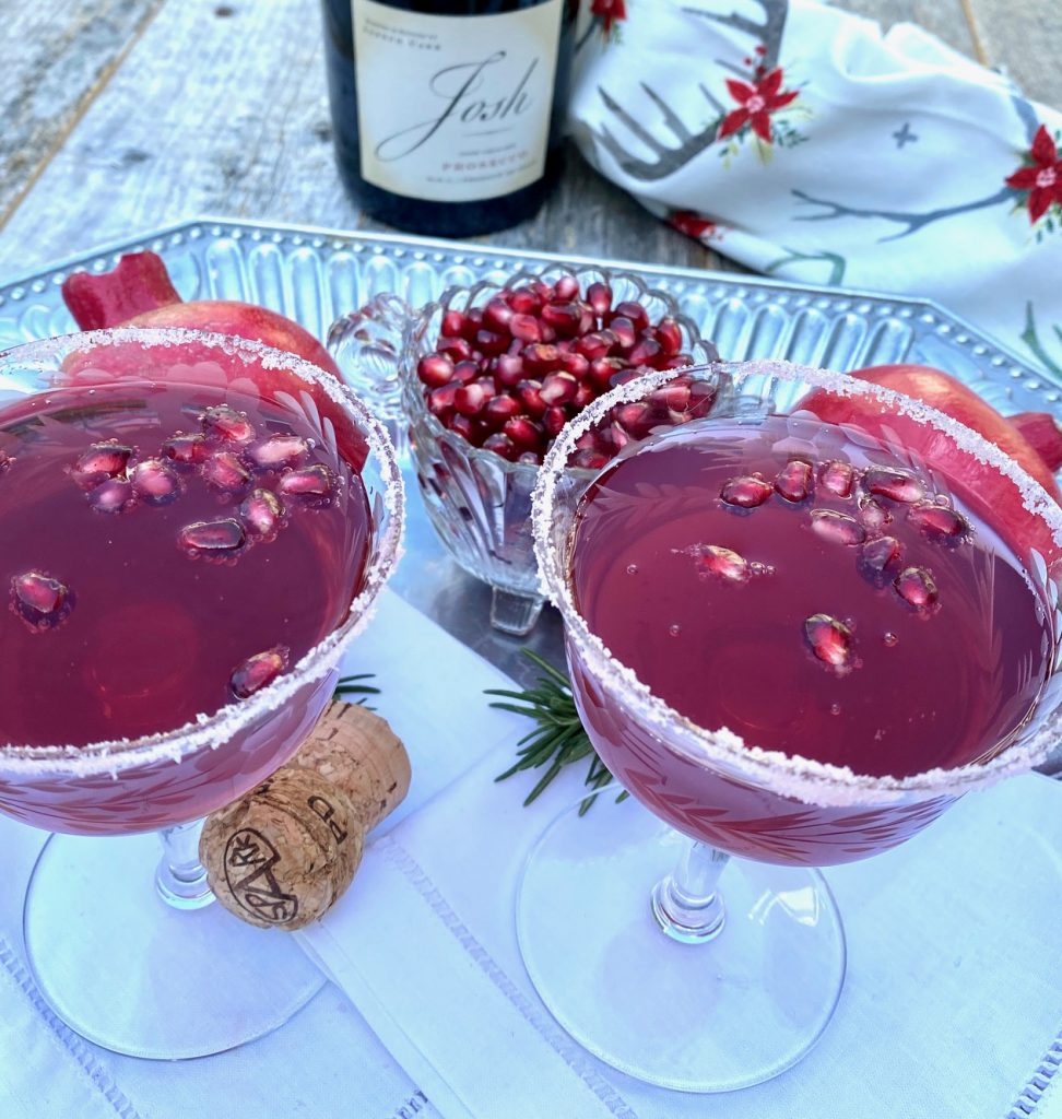 2 pomegranate cocktails and a bowl of pom seeds