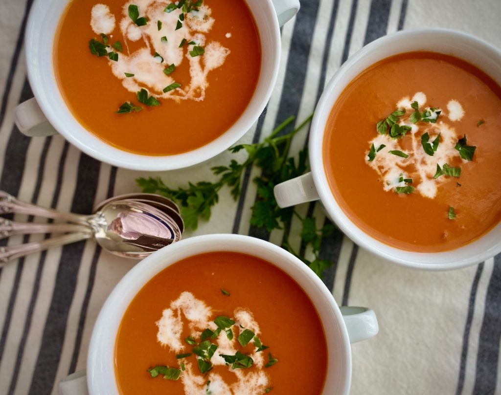 3 bowls Roasted Tomato Soup with garnishes
