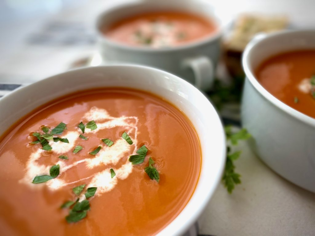Roasted Tomato Soup in white bowls