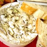 Baked Brie with garlic and herbs with bread and crackers