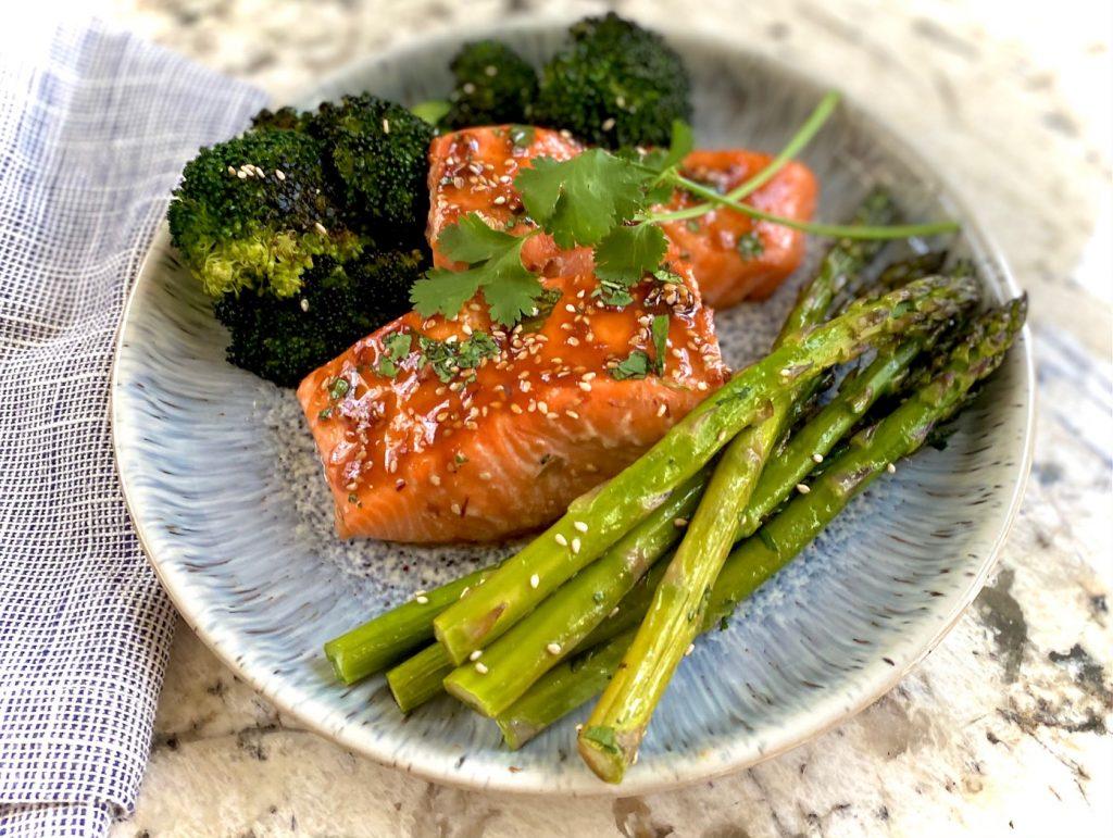 Salmon, asparagus and broccoli on blue plate
