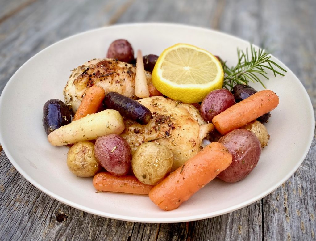 Sheet pan chicken and vegetables in a bowl