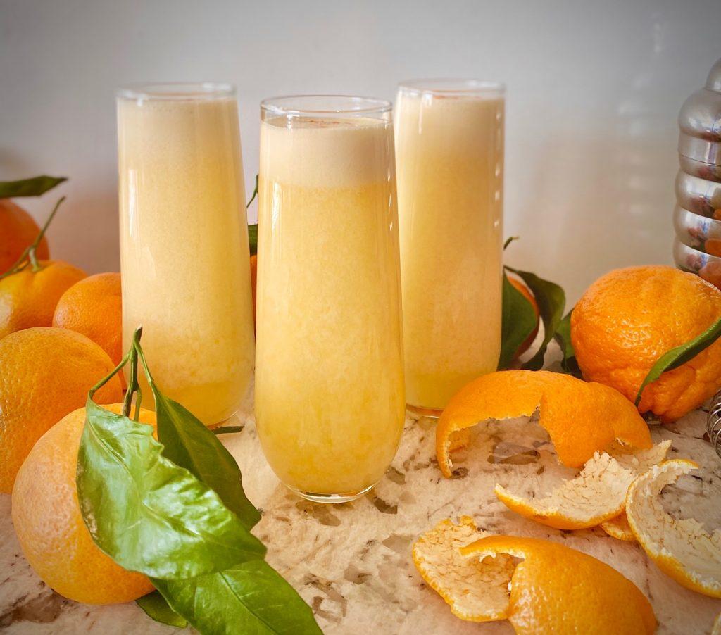 3 Orange Creamsicle Martinis with oranges