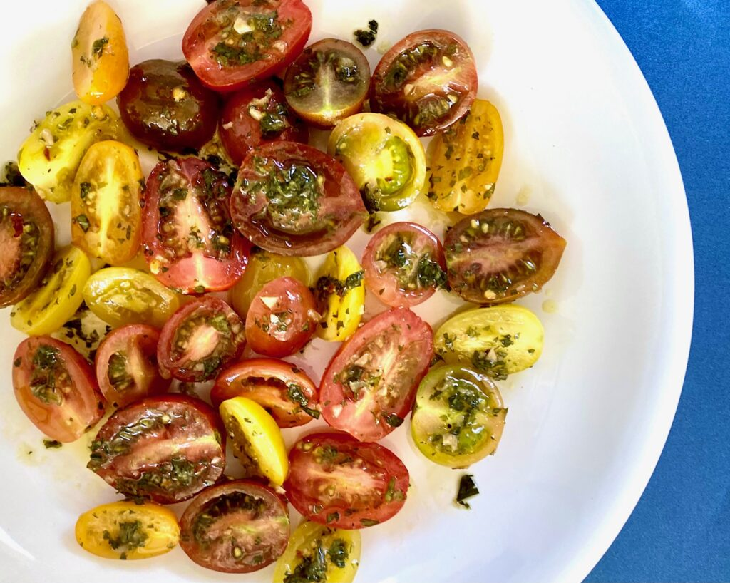 Chimichurri cherry tomatoes in white bowl