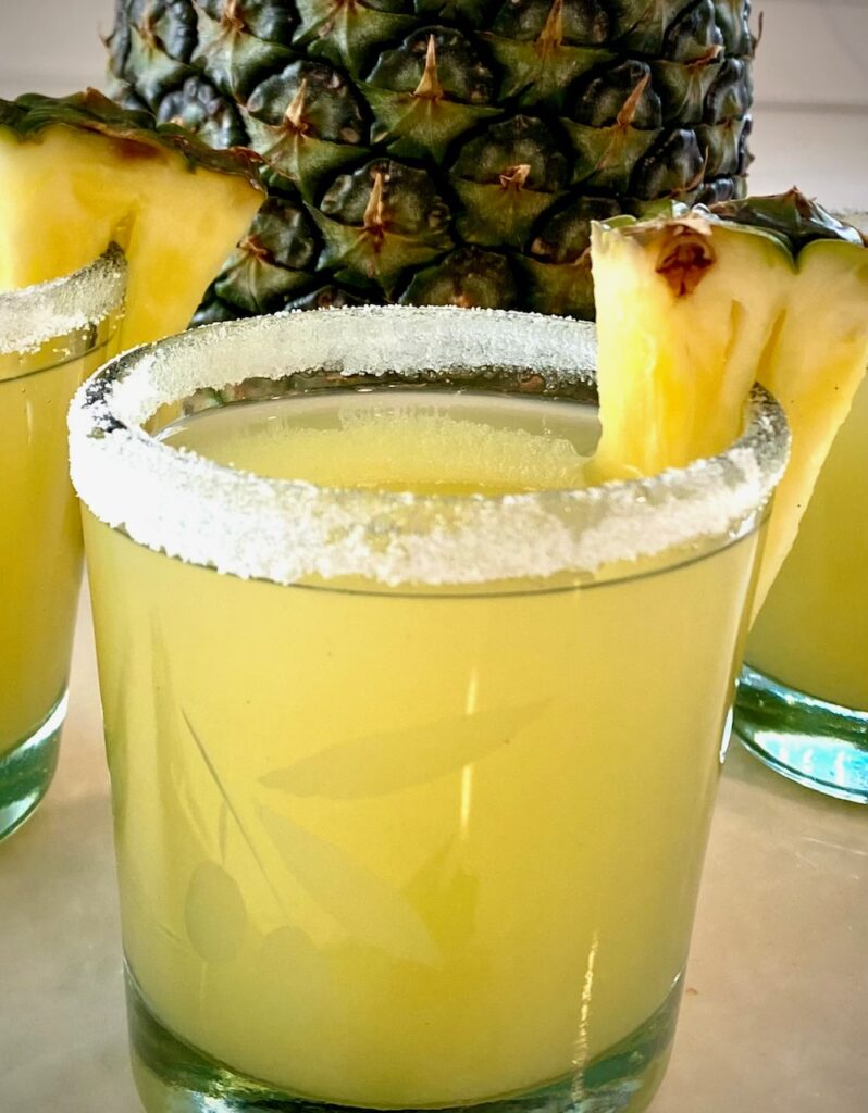 Martini with pineapple in a glass