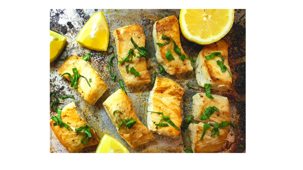 seared pieces of halibut and lemons