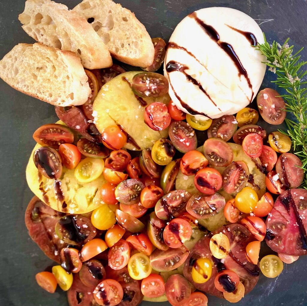 platter of burrata and tomatoes