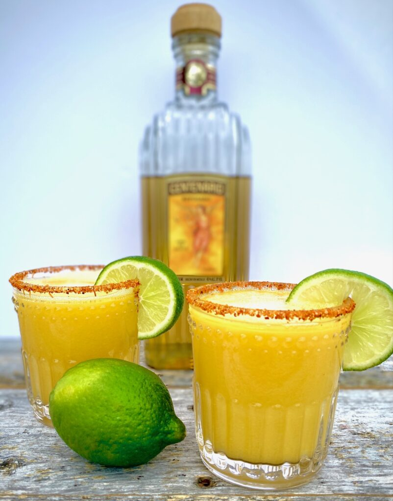 2 mango margaritas with a bottle of tequila