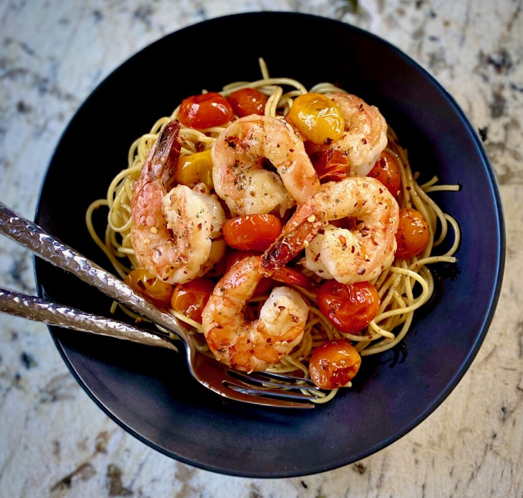 Black bowl with Shrimp and Tomatoes