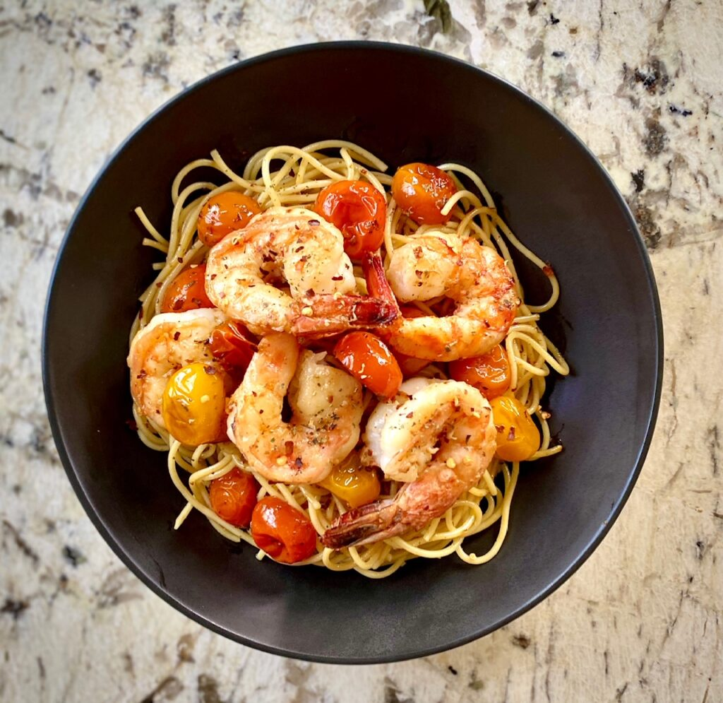 Bowl of pasta shrimp and tomatoes