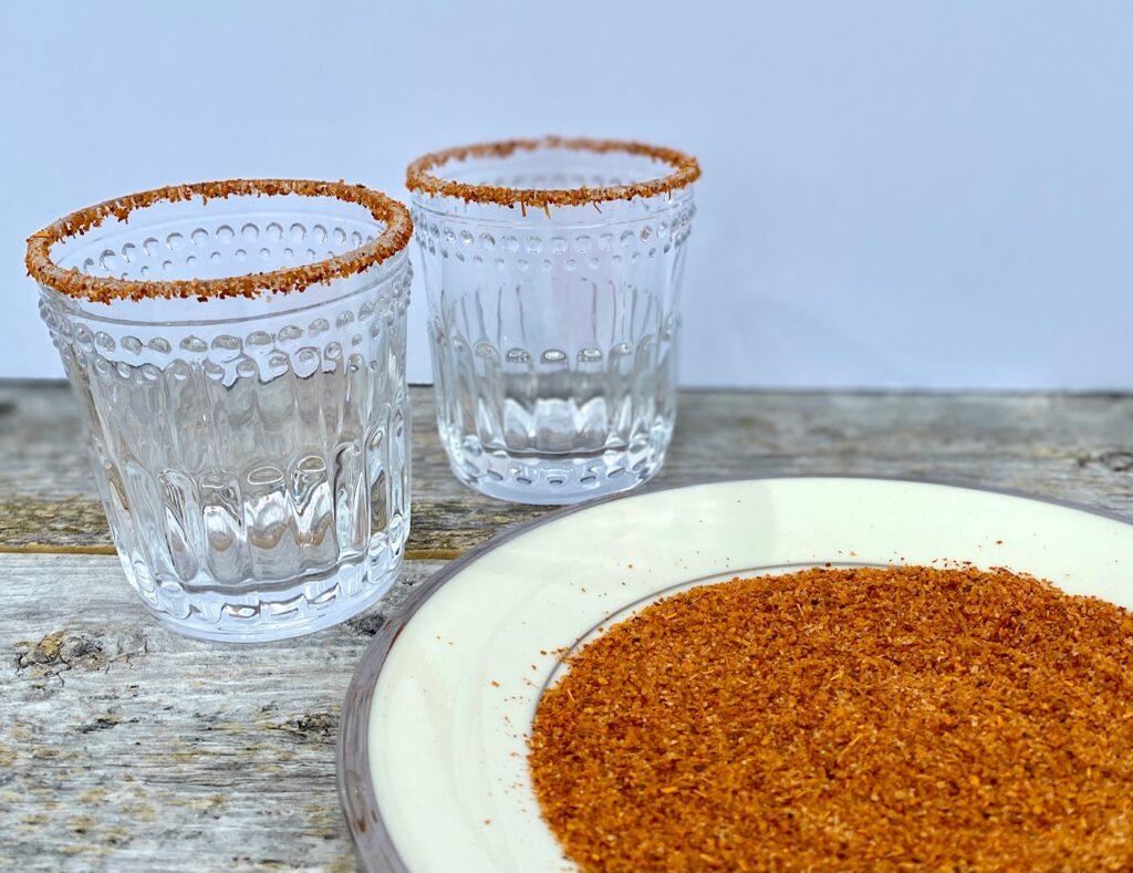 2 glasses coated in Tajin seasoning