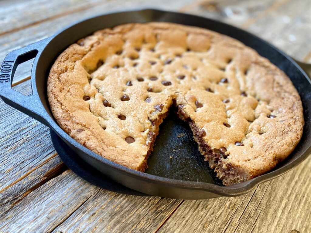 choc chip skillet cookie with slice cut