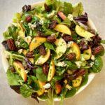 Fresh salad with peaches