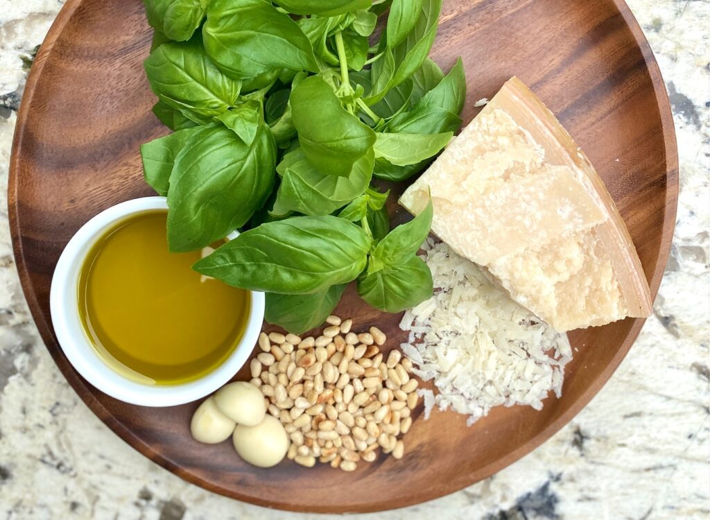 brown plate with pesto sauce ingredients