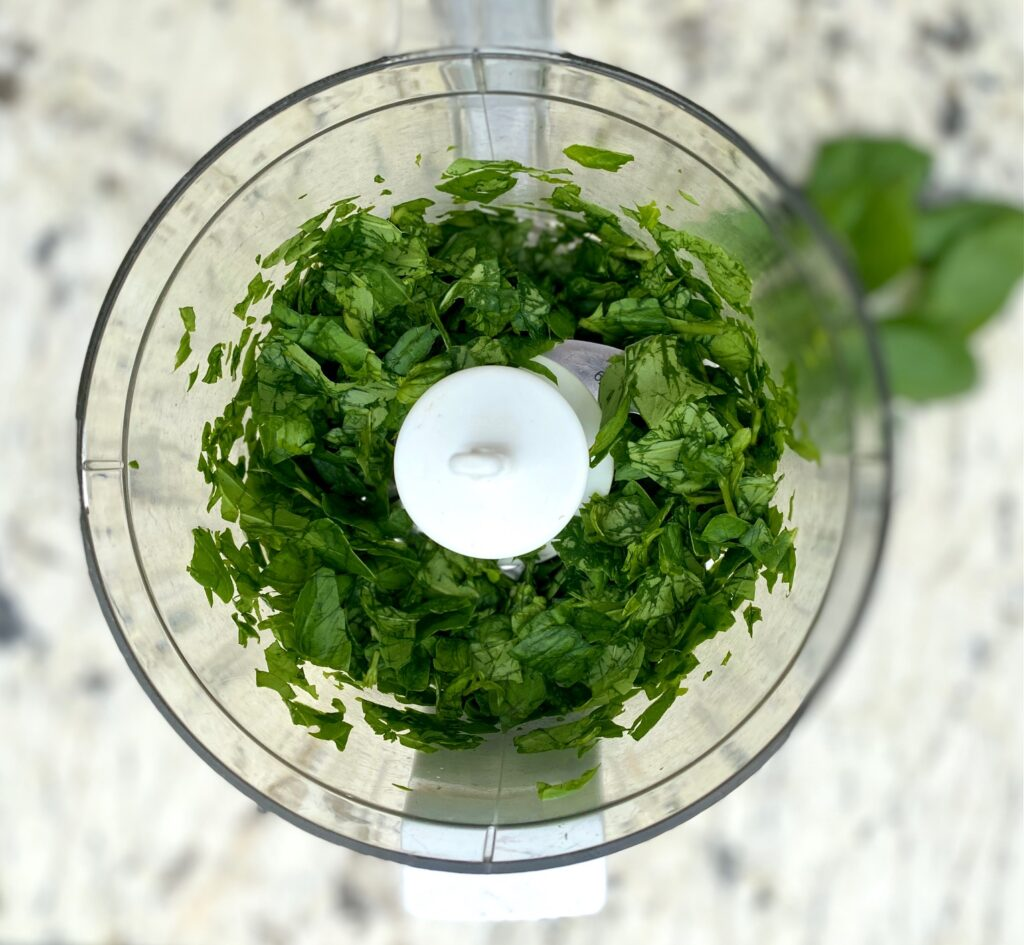 chopped basil in a food processor