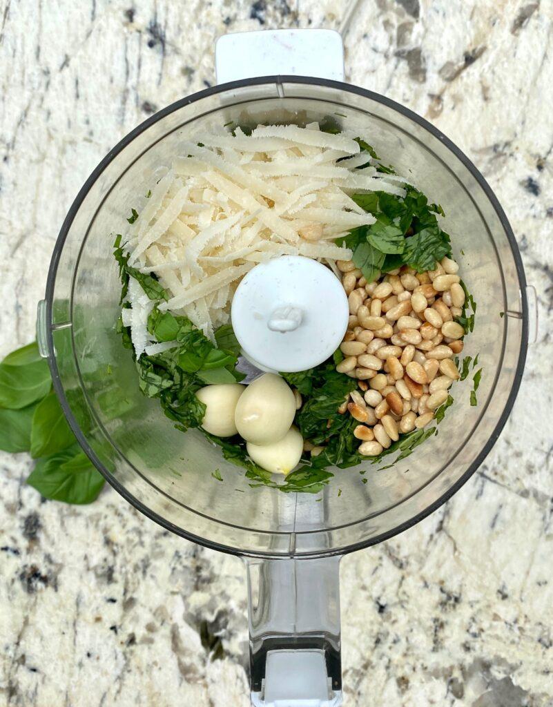 basil, pine nuts, garlic, parmesan in a chopper