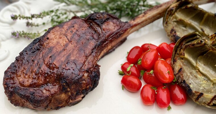Grilled steak with rosemary and tomatoes
