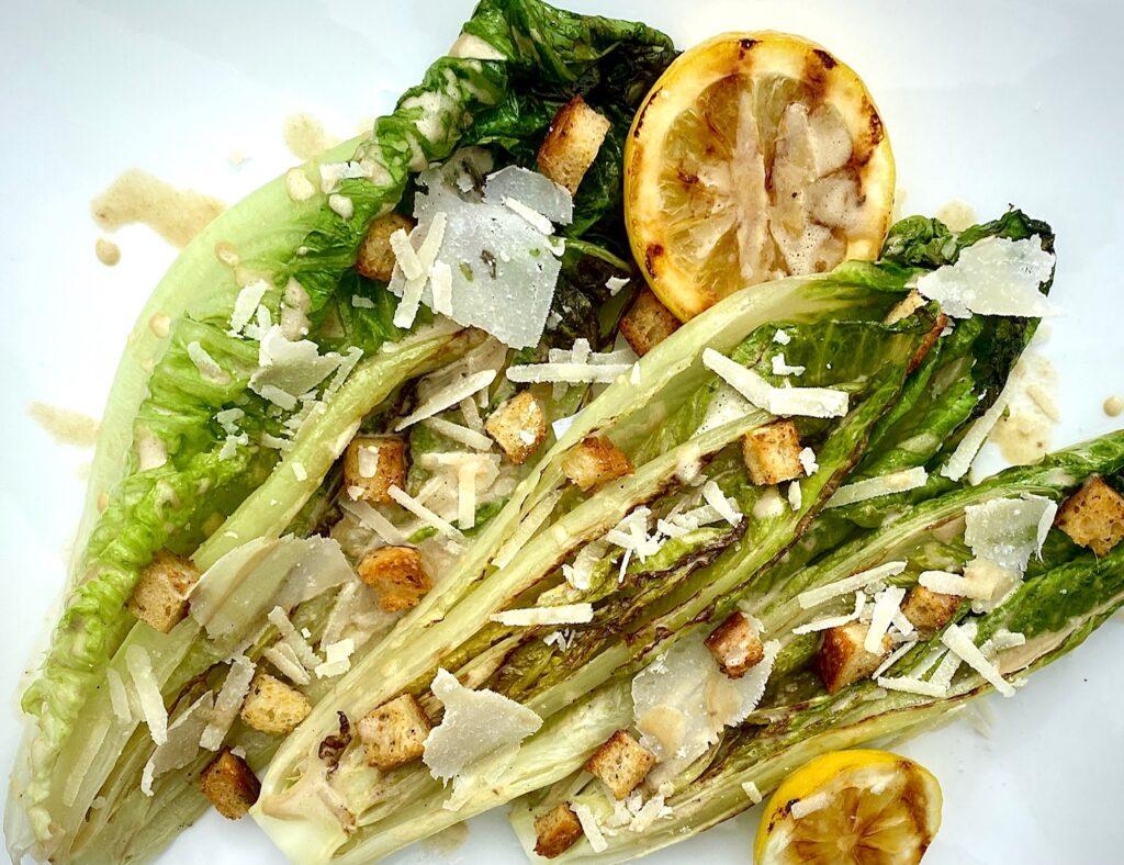 a grilled caesar salad on a platter