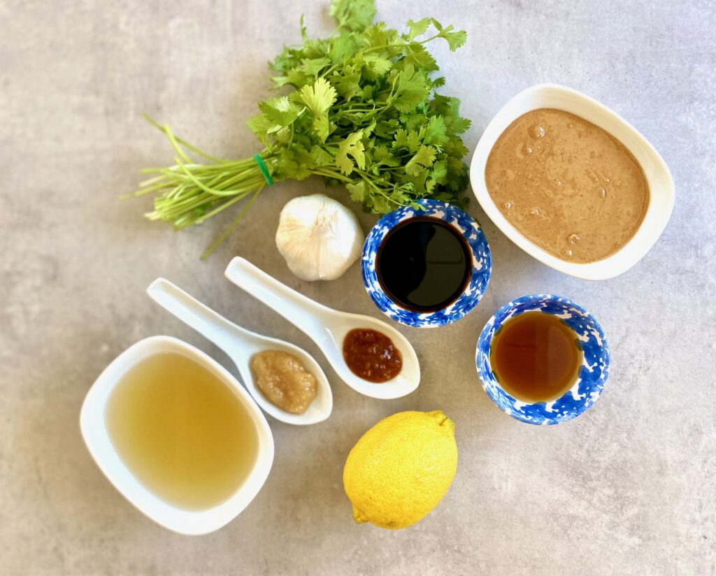 ingredients for peanut sauce in small cups