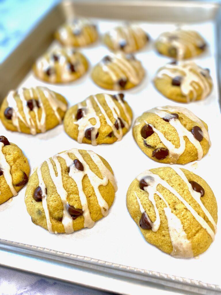 pumpkin cookies on a baking sheet