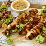 Grilled chicken shishkabobs on a tray