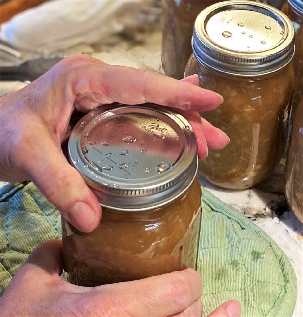 Add band to canning jar